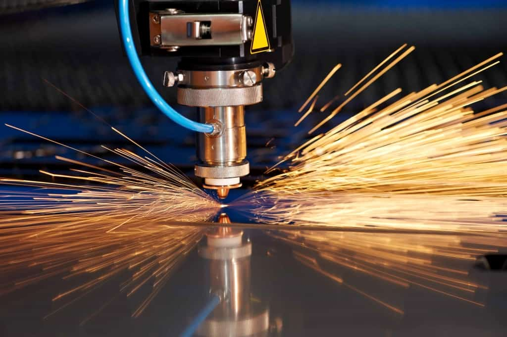 Laser cutting sheet metal with sparks - Marketing Zone